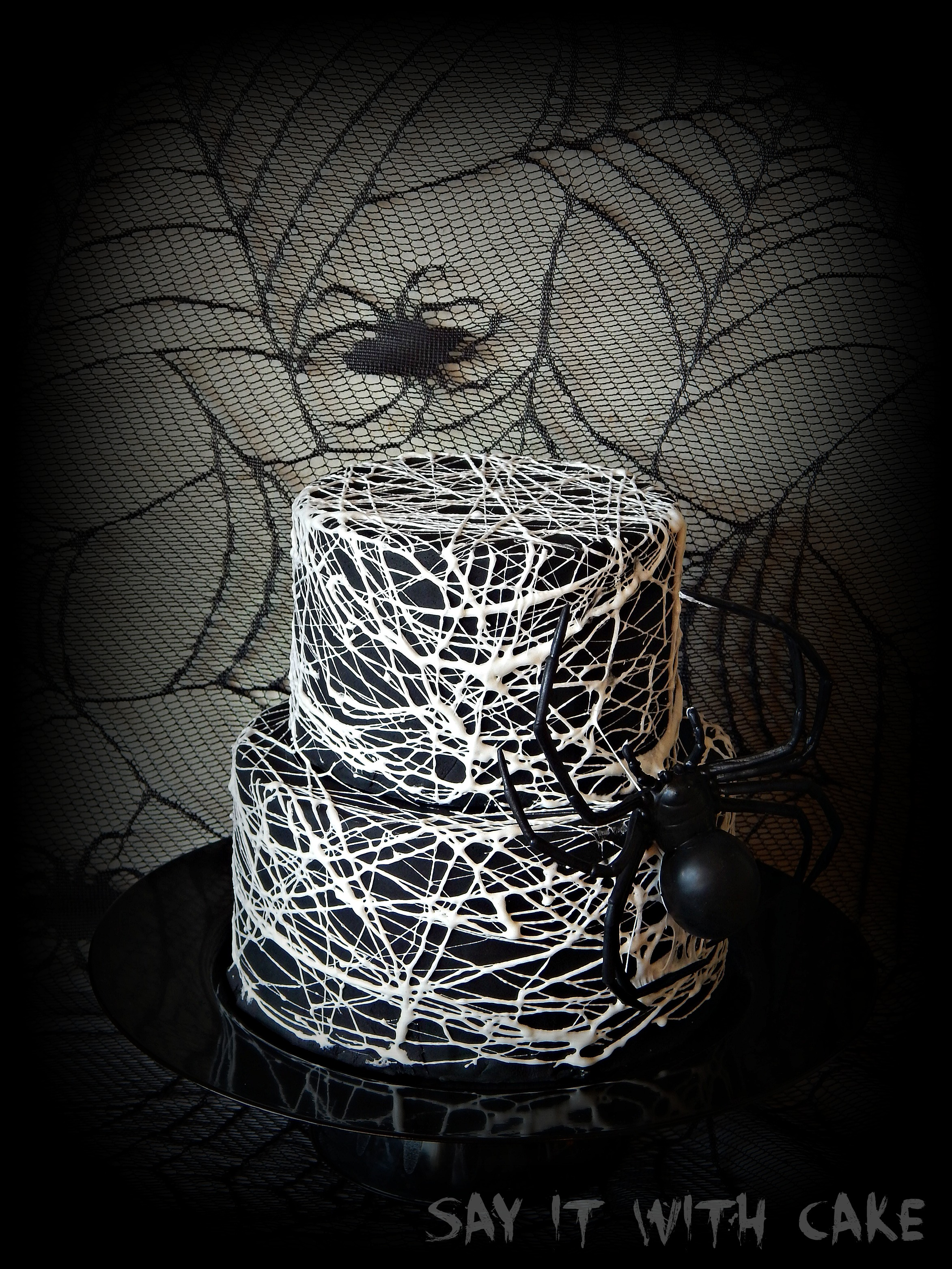 I just love the way this spider web looks, so creepy like a giant spider is  spinning its web around this cake lol!