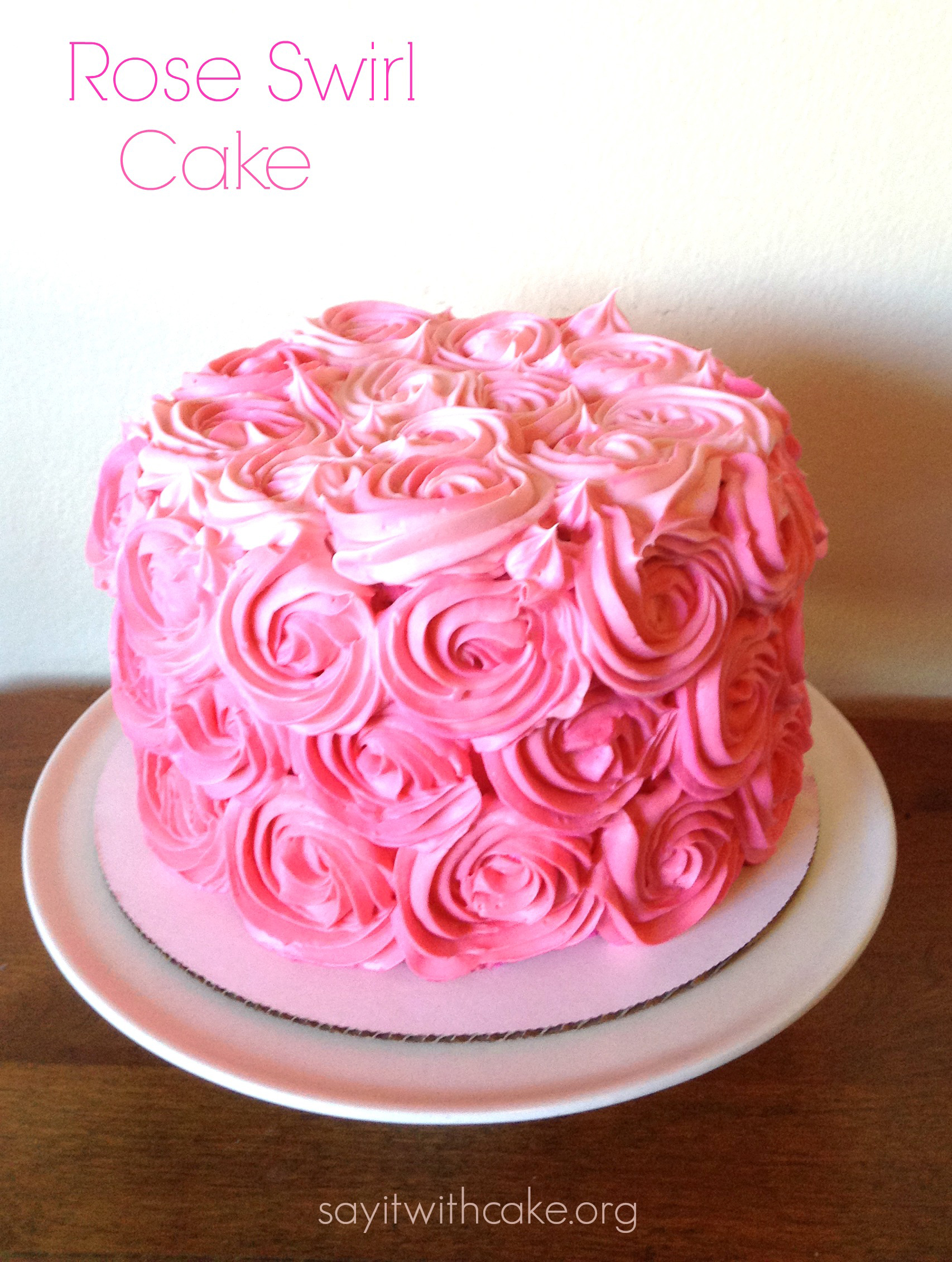 Pink rose swirl cake say it with cake you can see in this picture how i made a very subtle ombre effect with the roses from dark to light izmirmasajfo