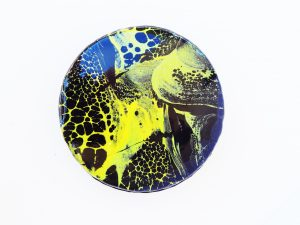 black and yellow mirror glaze spider web cake
